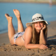 Girl sunbathing wearing hat — Stock Photo