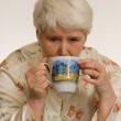 Woman drinking tea - Stockfoto