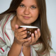 Stock Photo: Young womdrinking coffe