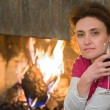 Stock Photo: Lady, wine, fireplace