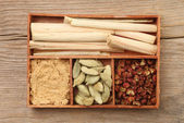Herbs and spice in a tray — Stock Photo