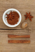 Spices and ramekin on wood — Stock Photo
