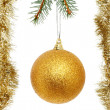 Gold ball and tinsel — Stock Photo