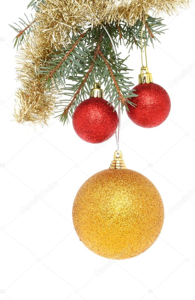 Red and gold Christmas baubles with tinsel hanging in a Christmas tree — Stock Photo #14254541