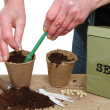 Hands planting seeds — Stock Photo #14471065