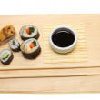 Sushi on a board — Stock Photo #14474509