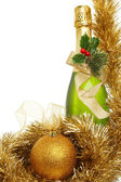 Champagne ball and tinsel — Stock Photo