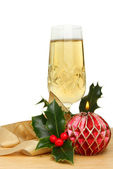 Champagne and Christmas decorations — Stock Photo