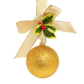 Gold ball bow and holly — Stock Photo