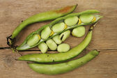 Beans on wood — Stock Photo