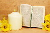 Prayer book and candle — Stock Photo