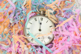 Pocket watch with party streamers — Stockfoto
