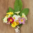 Posy of flowers on wood — Stock Photo