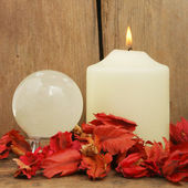 Candle pot-pouri and crystal ball — Stock Photo