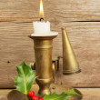 Brass candlestick and burning candle — Stock Photo