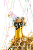 Champagne with party streamers — Stock Photo