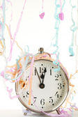 Clock and streamers — Stockfoto
