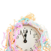 Clock face and party streamers — Stock Photo