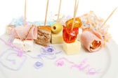 Party nibbles with streamers — Stock Photo