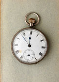 Pocket watch on paper — Stockfoto