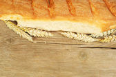 Bread loaf and wheat — Stock Photo