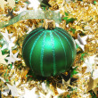 Christmas ball on tinsel — Stock Photo