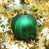 Christmas ball on tinsel — Stock Photo