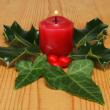 Candle holly and ivy — Stock Photo