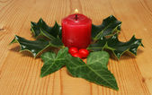 Candle holly and ivy — Stockfoto