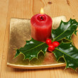 Candle and holly - Stockfoto