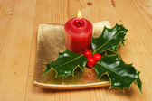Candle and holly — Stockfoto