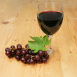 Stock Photo: Redwine and grapes