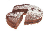 Cut chocolate sponge cake — Photo