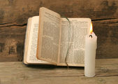 Prayer book and candle — Stok fotoğraf