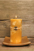 Yellow Feng Shui candle — ストック写真