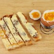 Boiled egg and soldiers — Stock Photo