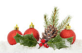 Baubles and foliage on snow — Stock Photo