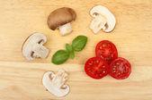 Mushrooms tomato and basil — Stock Photo