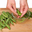 Hands shelling peas — Stock Photo #47976455
