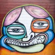 Graffiti face on wall — Stock Photo