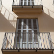 Balconies and windows illuminated with the light of noon - Stok fotoraf