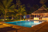 Resort Pool & Bar at night — Stock Photo
