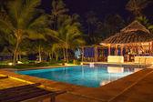 Resort Pool & Bar at night — Stock Photo