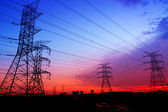 Silhouette electricity pylons — Stock Photo