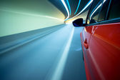 Night driving-motion blur tunnel light — Stock Photo