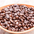 Stock Photo: Coffee bein bowl on grunge wood background