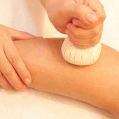 Reflexology leg massage by ball herbal, spa foot treatment by ba — Stock Photo