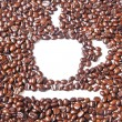 White coffee cup in many brown coffee beans for background — Stockfoto