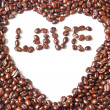 Heart from brown coffee beans and word of love — Stock Photo #31878479