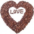 Heart from brown coffee beans and word of love — Stock Photo #31878509